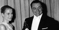 Borgnine receiving his Oscar from Grace Kelly in 1955
