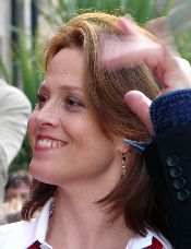 Sigourney Weaver waves to a fan at the premiere of Snow Cake