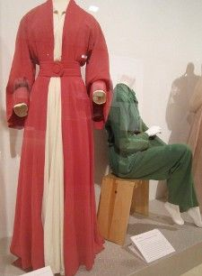 A Valentina red silk coat dress made for the original Broadway production of The Philadelphia Story and a green raw silk jumpsuit the private Hepburn wore