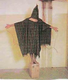 One of the iconic pictures from Abu Ghraib, branded Standard Operating Procedure by Brent Pack