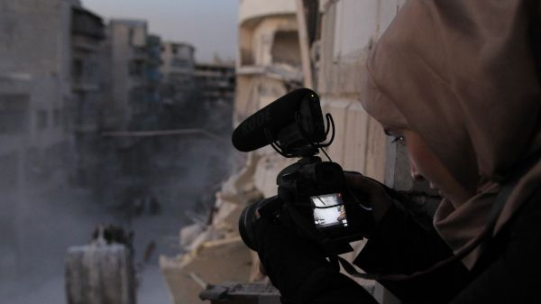 Waad al-Kateab filming the ruins of a building destroyed by bombing in besieged east Aleppo,October 2016.