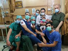 Hamza, Sama and the staff of al-Quds hospital, which Hamza set up in 2012 in east Aleppo