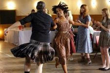 Iona (Ruth Negga) dancing at the ceildh