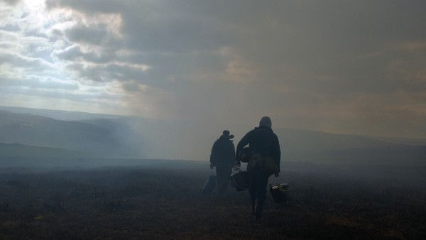Josh O'Connor and Alec Secareanu in God's Own Country - springtime in Yorkshire: isolated young sheep farmer Johnny Saxby numbs his daily frustrations with binge drinking and casual sex, until the arrival of a Romanian migrant worker, employed for the lambing season, ignites an intense relationship that sets Johnny on a new path.