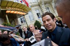 John Travolta obliges autograph hunters in Karlovy Vary.