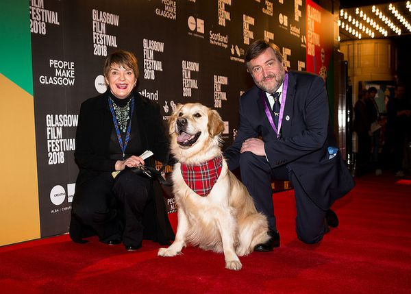 Festival directors Allison Gardner and Allan Hunter with George the Ambassadog on the Isle Of Dogs red carpet in 2018