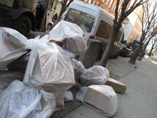 7000 Oaks in New York City with recycling waiting to be picked up by sanitation.