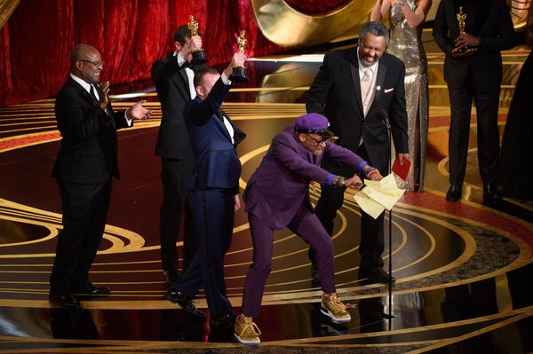 Spike Lee celebrates his win for Best Adapted Screenplay