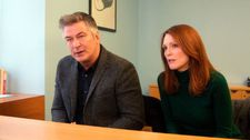 "Alice with John (Alec Baldwin): ""Something about the situation he just can't deal with."""