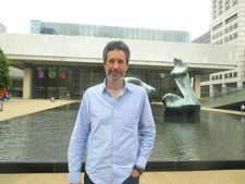 "Antonin Baudry in front of the Henry Moore sculpture on the plaza of Lincoln Center: ""I love ambiguous sounds. I love the sounds where you don't know if it's an organic sound or a machine."""