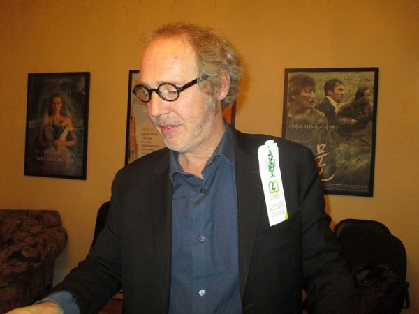 Arnaud Desplechin shows off Film4Climate bracelet from Anne-Katrin Titze