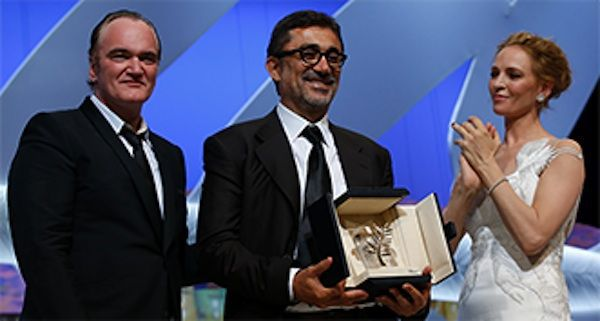 Quentin Tarantino and Uma Thurman present the Palme d'Or to Nuri Bilge Ceylan for Winter Sleep.