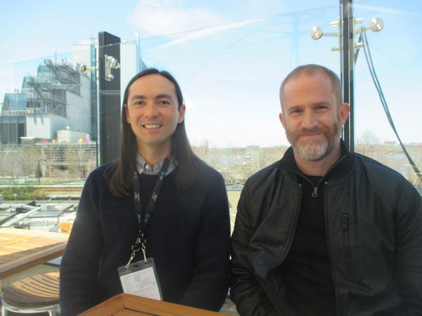 This Is Climate Change‬ creators ‪Danfung Dennis and Eric Strauss‬ on the STK Downtown rooftop with the Whitney Museum of American Art in the background