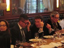Bertrand Bonello makes a point to Dennis Lim at the uniFrance lunch