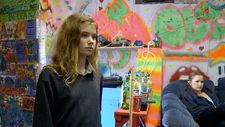 Florrie in the band room of Headfort School with gap year student Olivia