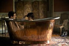 "Count Louis d'Orsay (Gaspard Ulliel) with Loïe Fuller (Soko): ""An obsession among French people for bathtubs."""
