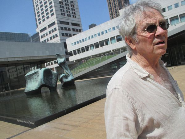 Hampton Fancher at the reflecting pool with Henry Moore's Reclining Figure (Lincoln Center) 1963–5