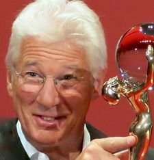 Globe trotter: Richard Gere proudly receives his Crystal Globe for career achievement at tonight's opening (3 July) of the 50th anniversary edition of the Karlovy Vary International Film Festival