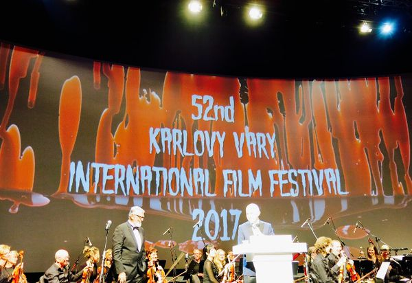 Blood and gore was the theme of the opening night of the Karlovy Vary International Film Festival, devised by brothers Michael and Simon Caban. The aim was to evoke gothic films from the silent era - accompanied by the ranks of the Karlovy Vary Symphony Orchestra. On stage, left, is Festival President Jiří Bartoška.
