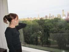 Isabelle Huppert looking out onto Central Park