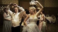 "John Hurt with Kirsten Dunst in Melancholia: ""I love working with Lars! I've worked with him three times. I did the narration of Dogville and Manderlay"