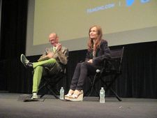 "John Waters shares a laugh with Isabelle Huppert: ""Do you ever crack up in the middle of a really extreme scene?"""