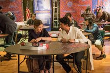 Agnes (Kelly Macdonald) and Robert (Irrfan Khan) work on a 1,000 piece jigsaw puzzle in competition
