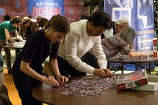 Agnes (Kelly Macdonald) and Robert (Irrfan Khan) jigsaw puzzling.