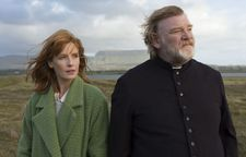 "Kelly Reilly as Fiona with Father James, Brendan Gleeson: ""John Michael's vision of this character. He already arrived with the idea of this green coat."""