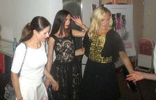Livia Firth with Marchesa co-founders Georgina Chapman and Keren Craig getting a hand