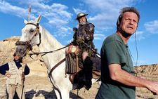 Jean Rochefort saddled up as Don Quixote on location in Spain with Terry Gilliam