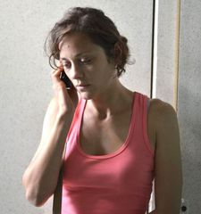 "Marion Cotillard as Sandra: ""The pink top she wears, tells a number of things."""