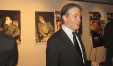 Matt Brown in front of Weegee photos at the Bow Tie Chelsea Cinemas