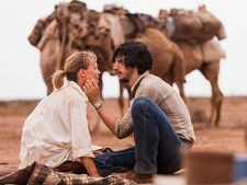 Mia Wasikowska as Robyn Davidson and Adam Driver as Rick Smolan: