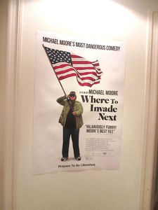 The Where To Invade Next poster on Michael Moore's door