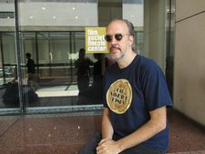 New York Film Festival Director Kent Jones in front of the Film Society of Lincoln Center logo from the past