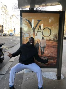 All aboard: Omar Sy beside a poster for his new film Yao at a Paris bus stop