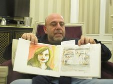 Paolo Virzì shows off his notebook with watercolors of his daughter and Gary Greengrass