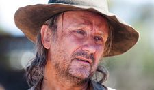 Rainer Bock as camel rancher Kurt Posel in Tracks: