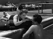 Florence (Sally Forrest) with Gordon (Robert Clarke) at the pool in ‪Hard, Fast And Beautiful