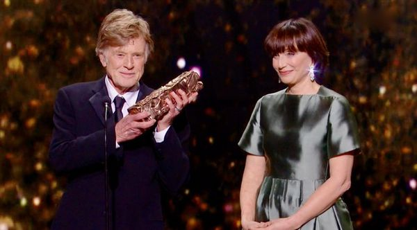 Robert Redford receives his honorary César from Kristin Scott Thomas at the César awards ceremony in Paris