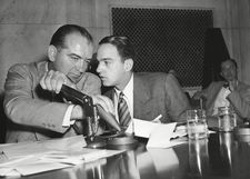 Roy Cohn whispers to Senator Joseph McCarthy at the Army-McCarthy hearings