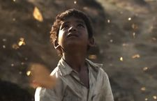 "Saroo (Sunny Pawar): ""He describes this hedge that was filled with butterflies."""