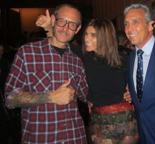 Terry Richardson and Carine Roitfeld, giving me the thumbs up with the evening's dapper host Charles Cohen.