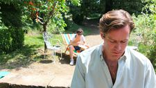 Oliver and Elio in the garden with the peach tree