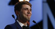 An emotional Xavier Dolan, shared the Jury Prize for his film Mommy with Jean-Luc Godard
