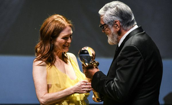 Julianne Moore receives her Crystal Globe for career achievement from Karlovy Vary Film Festival president Jiří Bartoška at the opening ceremony