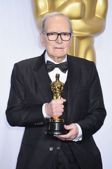 Ennio Morricone with his Oscar for The Hateful Eight