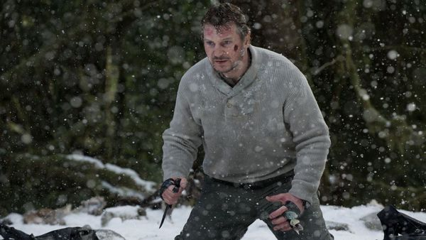 Liam Neeson faces off against a pack of wolves in The Grey