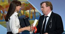 Timothy Spall receives his best actor award in Cannes from Monica Bellucci for Mr. Turner